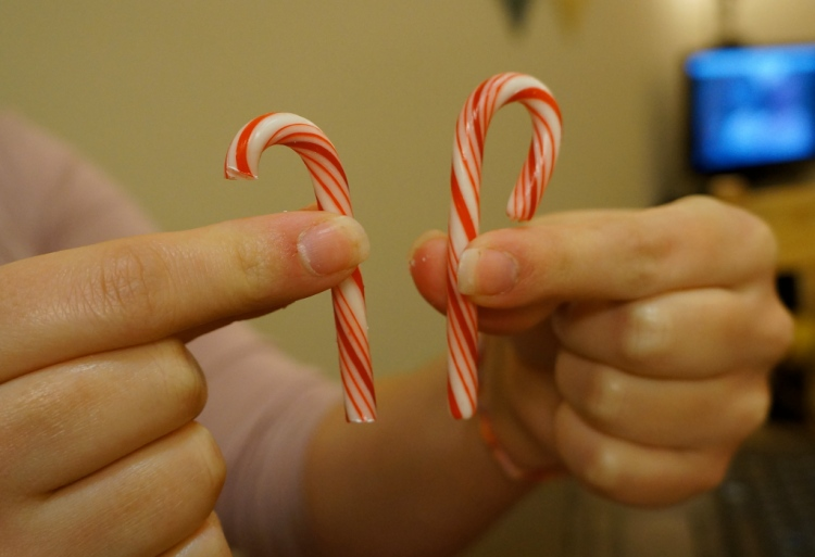 Cut candy canes to make sled