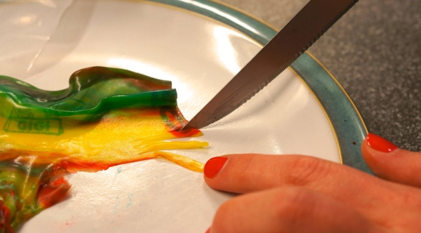 cutting fruit roll up