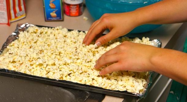 lay birthday popcorn on sheet